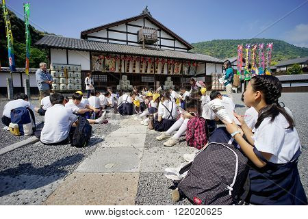 KAGAWA, JAPAN - MAY 8, 2015: Excursion of an Japanese elementary school, Observation of important historical Kanamaruza-building at Kotohira, Kagawa, Japan.