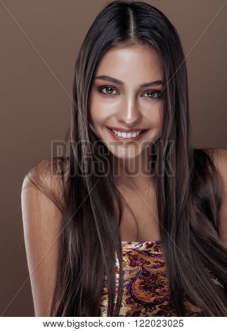 cute happy young indian woman in studio close up smiling gesturing, fashion mulatto beauty