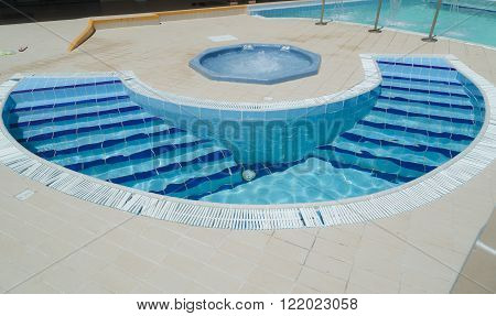 Cayo Coco island, Cuba, Sep 2, 2015, great amazing, inviting gorgeous closeup view of outdoor spa with Jacuzzi and small curved water pool with steps