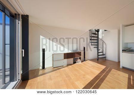 Interior, wide open space of a duplex, parquet floor