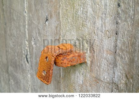 old rusty damaged hinge in the concrete wall ** Note: Shallow depth of field