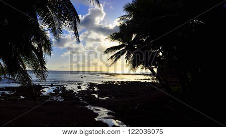 The sun setting at Sella Bay on the south side of Guam.