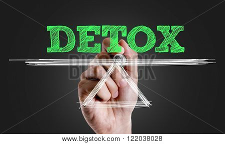 Hand writing the text: Detox