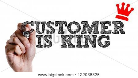 Hand writing the text: Customer is King