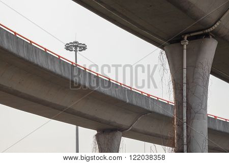 Shanghai China 03/11/2016 Elevated parallel roads with orange handrail and street lantern