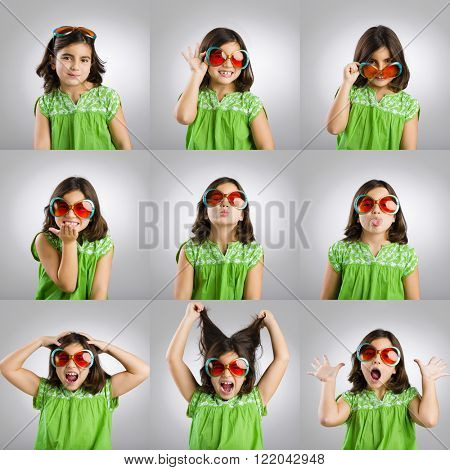 Multiple portraits of the same little girl making diferent and funny faces