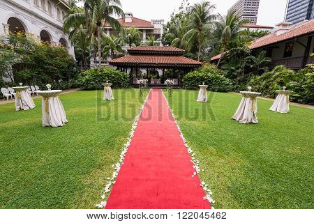 Singapore 16 June 2015: Setup for luxurious garden wedding ceremony at Raffles Hotel.
