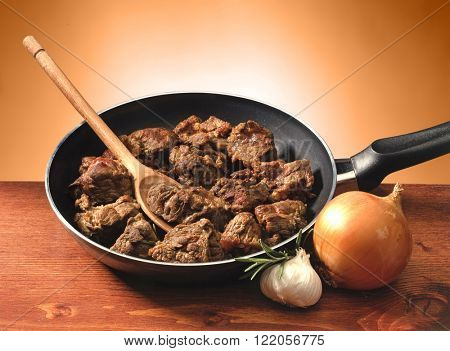 meat cooked in a pan