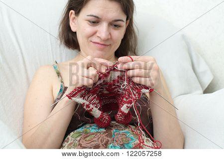 Smiling Woman  Knitting