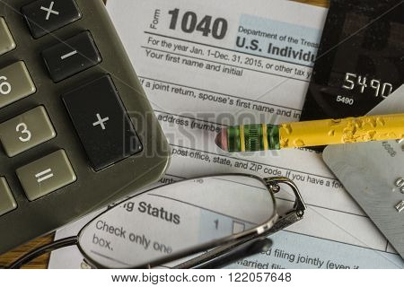 US tax form 1040 with pencil and calculator close up