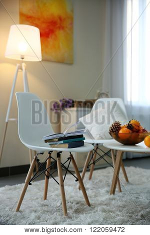 Room design with white furniture, picture and floor lamp over beige wall