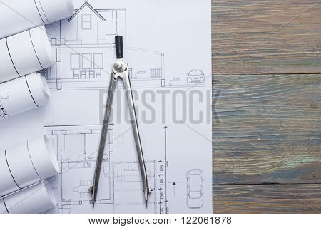 Architect worplace top view. Architectural project, blueprints, blueprint rolls and  divider compass on plans. Construction background. Engineering tools. Copy space.
