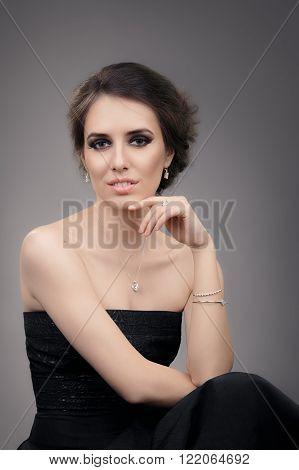 Beautiful Woman in Black Evening Dress Wearing Jewelry