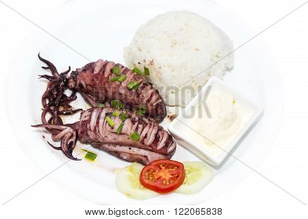 rice and salad and sauce grilled squid