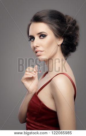 Beautiful Woman in Red Elegant Dress Wearing Ruby Jewelry
