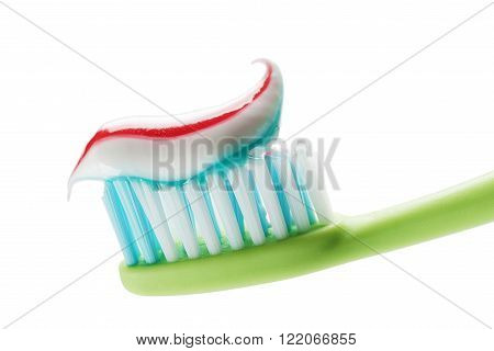 Toothbrush and toothpaste isolated on white close up.