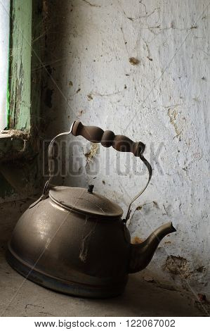 Old kettle for boiling water still life.