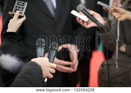 Journalists making media interview with spokesman or politician