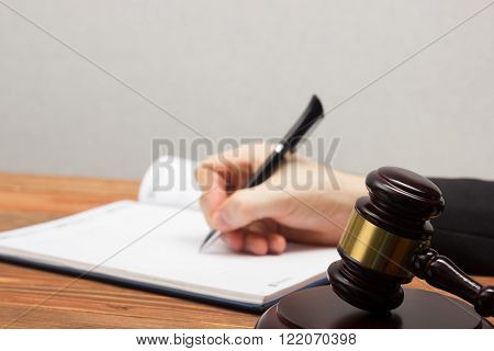 Lawyew working. Notary public signing document at his workplace