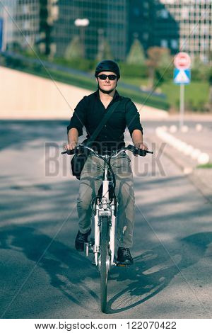 Businessman on electric bicycle on the street