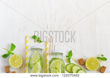 Lime cucumber parsley lemonade in bottles on a white background. Space for text