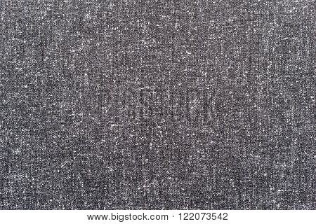 abstract speckled texture of dense fabric of gray color for textile backgrounds or for wallpaper