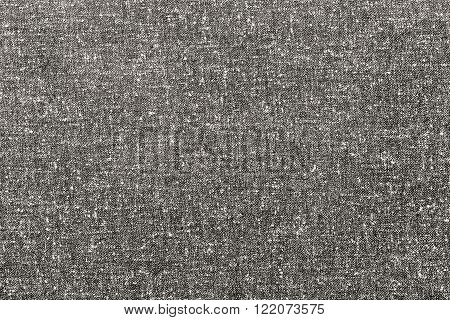 abstract speckled texture of dense fabric of beige color for textile backgrounds or for wallpaper