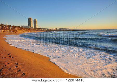 Barcelona city empty beach on the daybreak