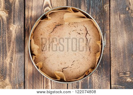 Healthy spelt cake in a round baking sheet