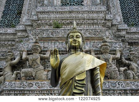 Golden buddha statue at Wat Arun the Temple of the Dawn also known as Wat Chaeng in Thonburi Bangkok Thailand.