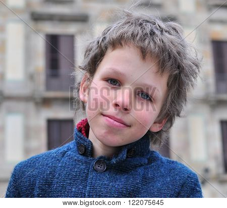 Portrait of a small shaggy caucasian boy
