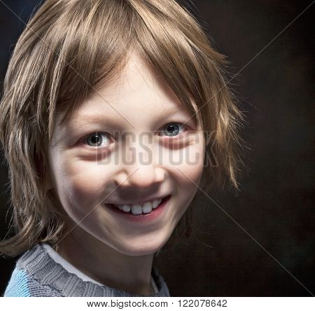 Portrait of a Boy with Blond Hair Smiling