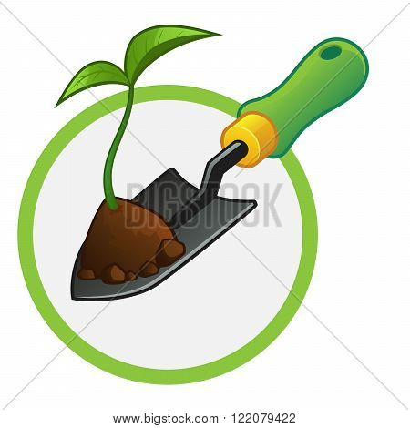 small gardening shovel with a plant and some soil