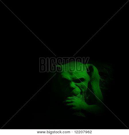 Green Gargoyle figure on black