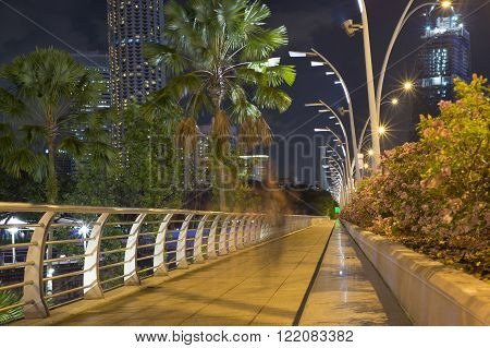 night well illuminated pathway in Singapore along Esplanade drive