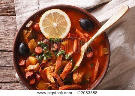 Solyanka - Russian Meat Soup In Bowl Closeup Horizontal Top View