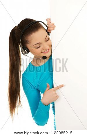 Call center woman pointing on billboard.