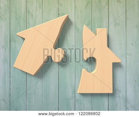Wooden house shape puzzles with two separated jigsaw pieces on green wood wall background.