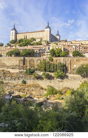 background landscape view of the walls of Toledo and Alcazar from the banks of the river Tagus, Castilla La Mancha, Spain