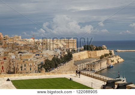 VALLETTA MALTA - OCTOBER 30 2015 : General view of Valletta Malta island with seascape port and historical limestone buildings from medieval times.