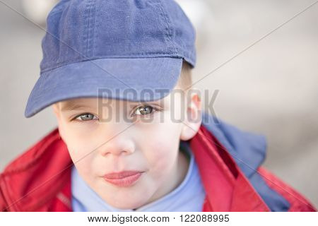 close up of a beautiful boy with blue eyes, outdoor portrait