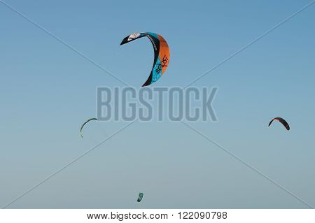 KITE BEACH, DUBAI - AUTUMN, 2015: Kite surfing area, parachutes in the sky