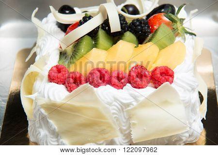 Fresh fruit flan cake with sweet cream