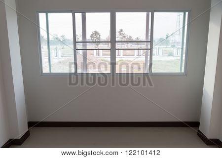 Room With Sliding Window And Beige Tile Floor