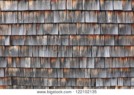 Detail of weathered wooden shingles in Austria