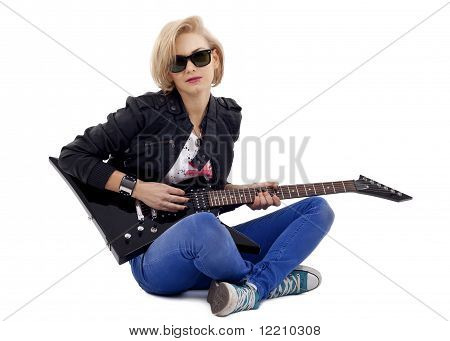 Rockstarl Playing An Electric Guitar On Her Knees