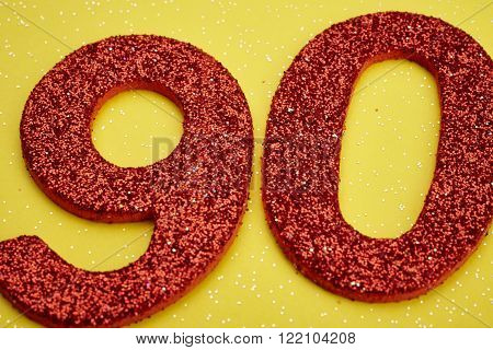 Number ninety red color over a yellow background. Anniversary. Horizontal