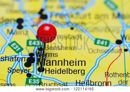 Photo of pinned Heidelberg on a map of Germany. May be used as illustration for traveling theme.