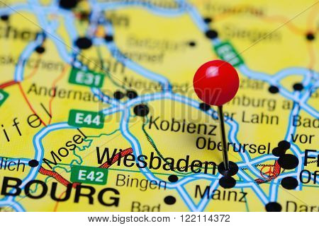 Photo of pinned Wiesbaden on a map of Germany. May be used as illustration for traveling theme.