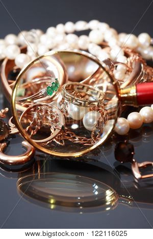 Set of various jewelry adornments through the magnifying glass